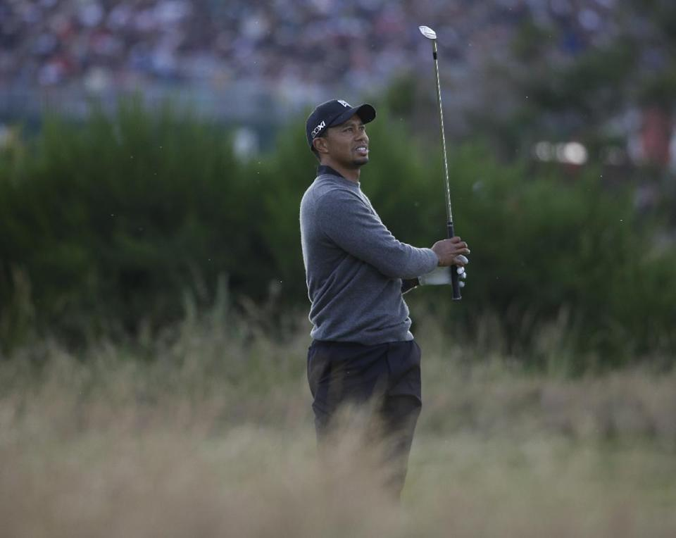 Tiger Woods of the United States plays a shot on the 16th hole at Royal Lytham & St Annes golf club during the second round of the British Open Golf Championship, Lytham St Annes, England, Friday, July 20, 2012. (AP Photo/Chris Carlson)