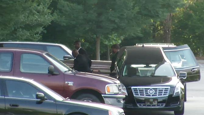 The body of  Bobbi Kristina Brown is removed from the hearse before a funeral service on  Saturday, Aug. 1, 2015, in Alpharetta, Ga.  Brown, the only child of Whitney Houston and R&B singer Bobby Brown, died in hospice care July 26, about six months after she was found face-down and unresponsive in a bathtub in her suburban Atlanta townhome.  (AP Photo/Johnny C. Clark)