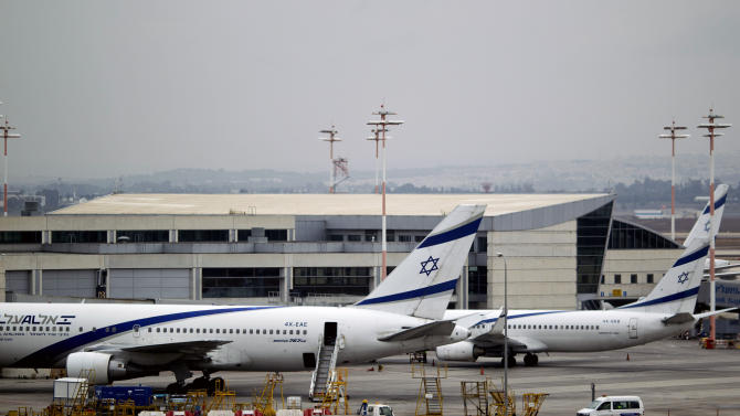 """Israeli airliner El Al planes parked at Ben Gurion airport near Tel Aviv, Israel, Sunday, April 21, 2013. Israel's three airlines went on strike Sunday over a proposed """"Open Skies"""" deal with the European Union that union workers say jeopardizes their jobs and could even cause the local airline industry to collapse. (AP Photo/Ariel Schalit)"""