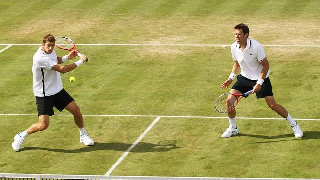 Daniel Nestor (R) Of Canada Looks Getty Images