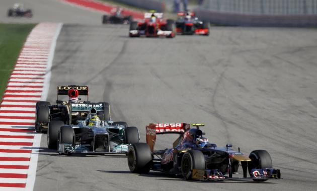 Daniel Ricciardo of Australia drives ahead of Nico Rosberg of Germany and Heikki Kovalainen of Finland during the Austin F1 Grand Prix at the Circuit of the Americas in Austin