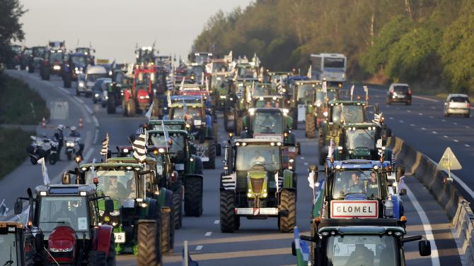 French farmers from western France regions drive their tractors on the A10 motorway outside Paris