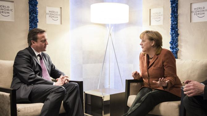 In this picture publicly provided by the German Government's Press Office, German chancellor Angela Merkel , right,  talks with British Prime Minister  David Cameron , during the World Economic Forum  in Davos, Switzerland, Thursday Jan. 24, 2013. (AP Photo/Jesco Denzel /Bundespresseamt)
