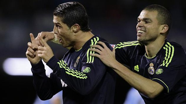 Real Madrid&#39;s Cristiano Ronaldo (L) celebrates his goal against Celta Vigo with his teammate Pepe (Reuters)