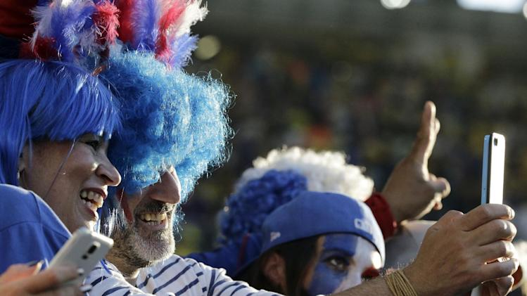 France fans take a selfie prior to the group E World Cup soccer match between Ecuador and France at the Maracana Stadium in Rio de Janeiro, Brazil, Wednesday, June 25, 2014
