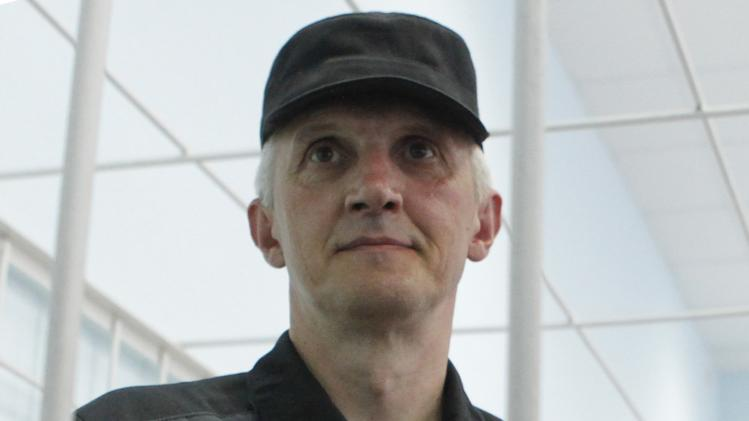 File photo of Lebedev, then jailed business partner of Russian ex-tycoon Khodorkovsky, looking out from the defendant's box during a court hearing in Velsk