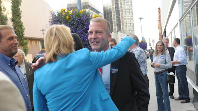 Republican U.S. Senate candidate Dan Sullivan receives a hug from a supporter in downtown Anchorage, Alaska on Tuesday, Aug. 19, 2014. (AP Photo/Michael Dinneen)