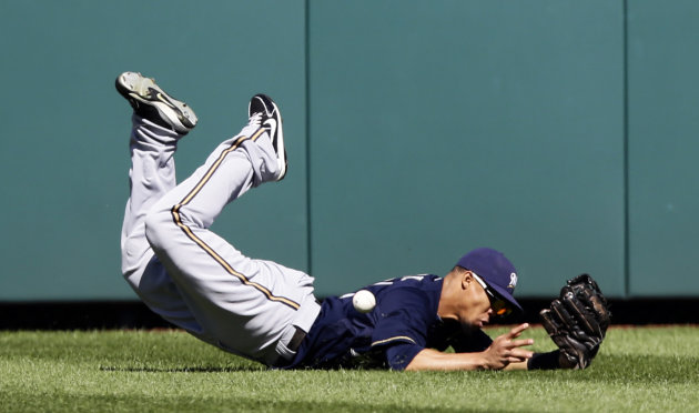 Milwaukee Brewers center fielder Carlos Gomez misses a ball hit by Washington Nationals&#39; Jayson Werth, who had a two RBI double on the play, during the fourth inning of a baseball game, Monday, Sept. 24, 2012, in Washington. The Nationals won 12-2. (AP Photo/Alex Brandon)