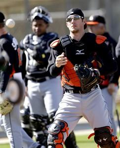 Miami Marlins catcher Jeff Mathis tosses a baseball on Feb. 18, 2013, in Jupiter, Fla. THE CANADIAN PRESS/AP, Julio Cortez