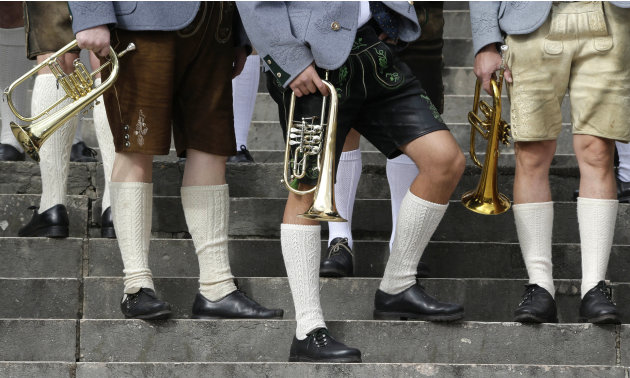 Musicians of the Oktoberfest orchestra arrive for the famous Oktoberfest beer festival concert in Munich, southern Germany, Sunday, Sept. 30, 2012. The world's largest beer festival, to be held from S