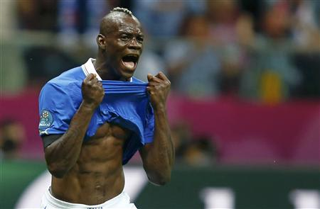 Italy's Balotelli celebrates his goal against Germany during their Euro 2012 semi-final soccer match at National Stadium in Warsaw