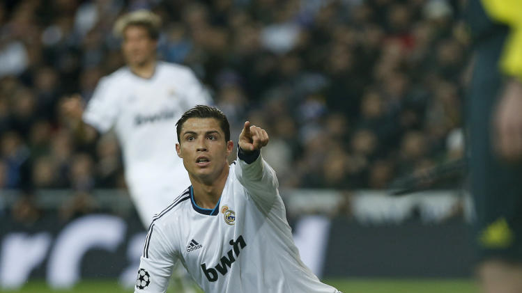 Real Madrid's Cristiano Ronaldo from Portugal gestures during the Champions League round of 16 first leg soccer match between Real Madrid and Manchester United at the Santiago Bernabeu stadium in Madrid, Wednesday Feb. 13, 2013. (AP Photo/Andres Kudacki)