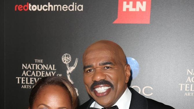 IMAGE DISTRIBUTED FOR EFG - Steve Harvey, right, and Marjorie Bridges seen at The 40th Annual Daytime Emmys Awards Redtouch Red Carpet, on Sunday, June 16, 2013 in Beverly Hills, Calif. (Photo by Ryan Miller/Invision for EFG/AP Images)