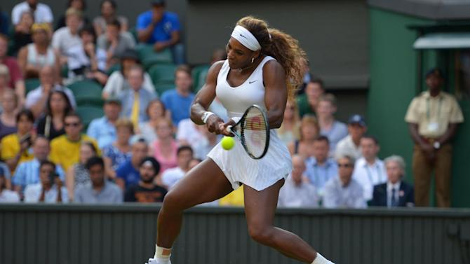 US player Serena Williams hits a return against US player Anna Tatishvili during their women's singles first round match on day two of the 2014 Wimbledon Championships at The All England Tennis Club in Wimbledon, southwest London, on June 24, 2014