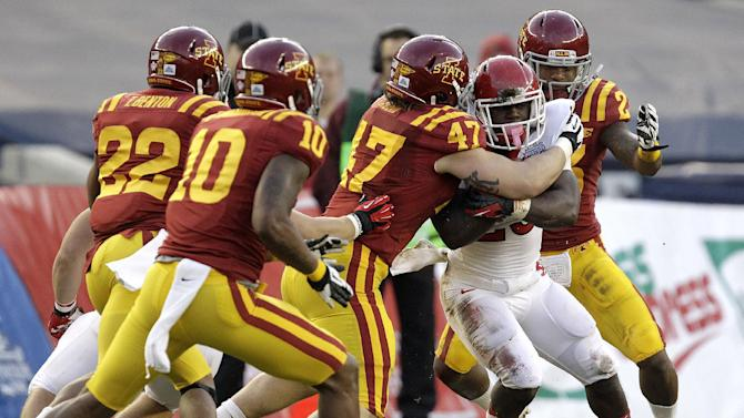 Rutgers running back Jawan Jamison, second from right, is tackled by Iowa State players in the first quarter of the Pinstripe Bowl NCAA college football game on Friday, Dec. 30, 2011, at Yankee Stadium in New York. ( AP Photo/Julio Cortez)