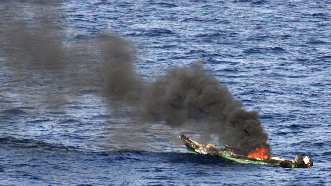 FILE - In this Saturday, April 10, 2010 file photo released by the U.S. Navy, a suspected pirates' skiff burns after being destroyed near the amphibious dock landing ship USS Ashland, part of the Nassau Amphibious Ready Group and 24th Marine Expeditionary Unit, at sea in the Gulf of Aden, about 330 nautical miles off the coast of Djibouti. A U.K.-led Piracy Ransom Task Force says the shipping industry must adopt additional measures to ensure that payments aren't made to pirates after a successful attack. (AP Photo/U.S. Navy, Chief Fire Controlman Harry J. Storms, File)