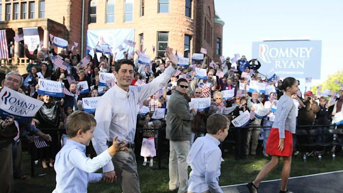 Republican vice presidential candidate Paul Ryan waves to the crowd with some of his children in tow, at the Clinton County courthouse in Clinton, Iowa, Tuesday, Oct. 2, 2012. (AP Photo/The Quad City Times, Kevin E. Schmidt)