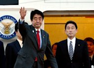 <p>Japanese Prime Minister Shinzo Abe (L), accompanied by Foreign Minister Fumio Kishida (R) leaves Tokyo International Airport to travel to the US, on February 21, 2013. Abe will have talks with US President Barack Obama for the first time since taking power.</p>