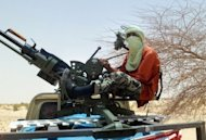An Islamist rebel mans a gun near Timbuktu in rebel-held northern Mali in April. Mali's Tuareg rebels clashed overnight with their former Islamist allies, witnesses said Friday, after the two groups fell out over forming a breakaway state in the northern desert region they control