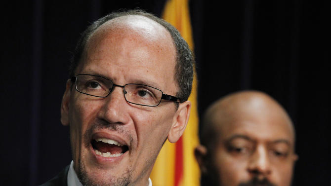 FILE - In this Thursday, May 10, 2012 file photo, United States Assistant Attorney General Thomas Perez, left, who heads up the civil rights division at the Department of Justice, is joined by Deputy Assistant Attorney General for Civil Rights, Roy Austin, as Perez announces a federal civil lawsuit against Maricopa County Sheriff Joe Arpaio during a news conference in Phoenix, after months of negotiations failed to yield an agreement to settle allegations that Arpaio's department racially profiled Latinos in his trademark immigration patrols. Two people familiar with the process say President Barack Obama is close to naming Perez as his choice to head the Department of Labor. (AP Photo/Ross D. Franklin, File)