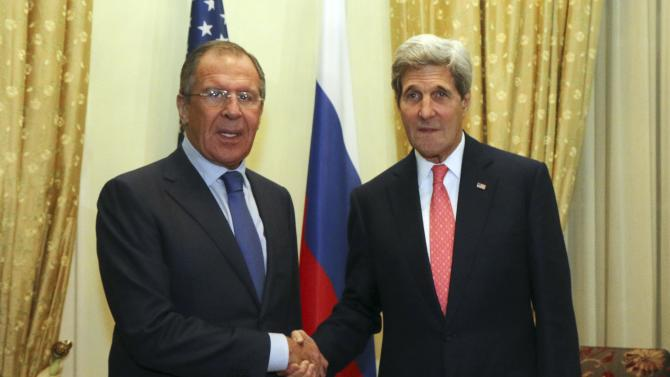 Russian Foreign Minister Lavrov and U.S. Secretary of State Kerry shake hands as they pose for a photograph prior to a bilateral meeting on the sidelines of the closed-door nuclear talks with Iran, in Vienna