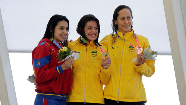 Alencar de Souza of Brazil, Toledo Salazar of Venezuela and Marangoni of Brazil with bronze medal, pose for the media during the awards ceremony for the women's swimming chest style 200m event at the South American Games in Santiago