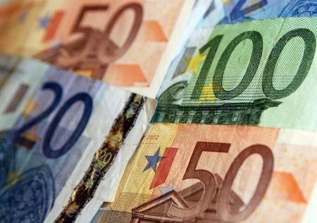 Euro on shaky ground, stocks up on talk of aggressive ECB easing