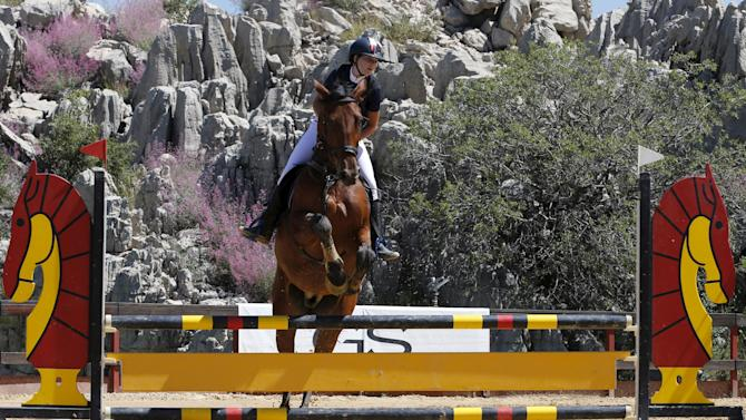 A person rides a horse at Faqra Equestrian Club in Faqra, Mount Lebanon,