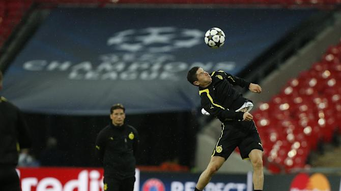Dortmund's Robert Lewandowski of Poland controls a ball during a training session at Wembley Stadium in London, Friday May 24, 2013. Dortmund will face fellow German soccer team Bayern Munich in the final of the Champions League at Wembley Stadium on Saturday. (AP Photo/Matt Dunham)