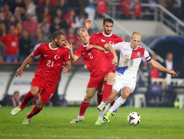 Turkey's Omer Toprak, left and Semih Kaya, center fight for the ball with Arjen Robben of Netherlands, right, during their World Cup Group D qualifying soccer match at Sukru Saracoglu Stadium in Istan