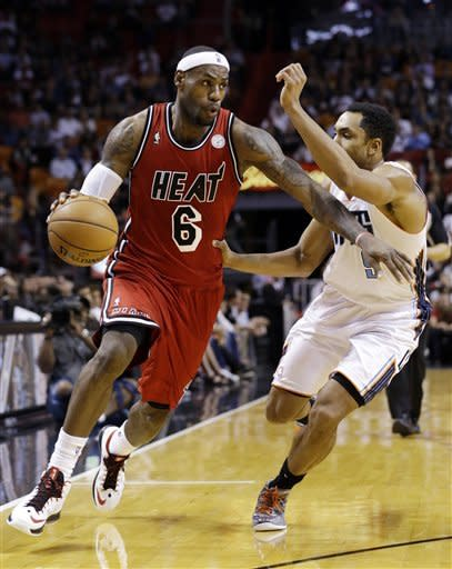 James scores 31, Bosh adds 23 as Heat beat Bobcats