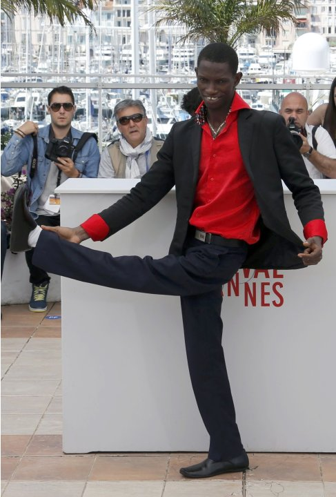 "Cast member Souleymane Deme poses during a photocall for the film ""Grigris"" at the 66th Cannes Film Festival"
