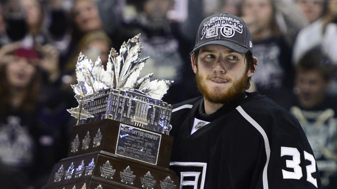 Los Angeles Kings goalie Jonathan Quick carries the Conn Smythe trophy as the most valuable player after the Kings beat the New Jersey Devils 6-1 to win the Stanley Cup during Game 6 of the NHL hockey Stanley Cup finals, Monday, June 11, 2012, in Los Angeles. (AP Photo/Mark J. Terrill)