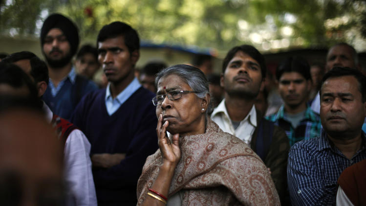 Indian people listen to a speaker, unseen, while they participate in a protest against a new sexual violence law as the parliament convenes in New Delhi, India, Thursday, Feb. 21, 2013. Activists say the law is inadequate and it only partially followed the recommendations of a government panel set up after the fatal gang rape of a woman in New Delhi led to nation-wide protests. (AP Photo/Altaf Qadri)