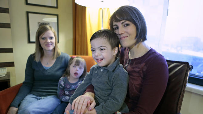 Jeana Bonner, left, of South Jordan, Utah, and Rebecca Preece from Nampa, Idaho, sit with their adopted children at a hotel in Moscow, Russia, Saturday, Feb. 9, 2013. After weeks of anxiety, plodding through the opaque Russian legal system and suffering wallet-thinning expenses, two U.S. women have custody of their adopted Russian children and are preparing to take them home to start a new life together.  (AP Photo/Mikhail Metzel)