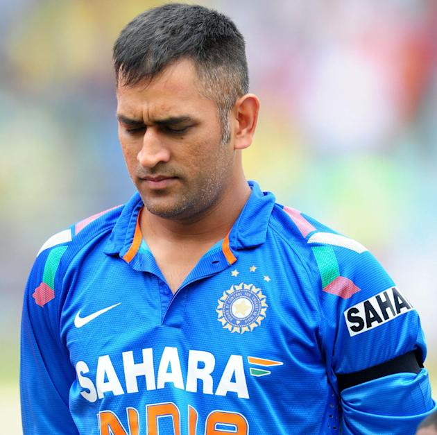 India's MS Dhoni, observes a period of silence for the passing of former South African president Nelson Mandela prior to the start of their One Day International cricket match against South Africa