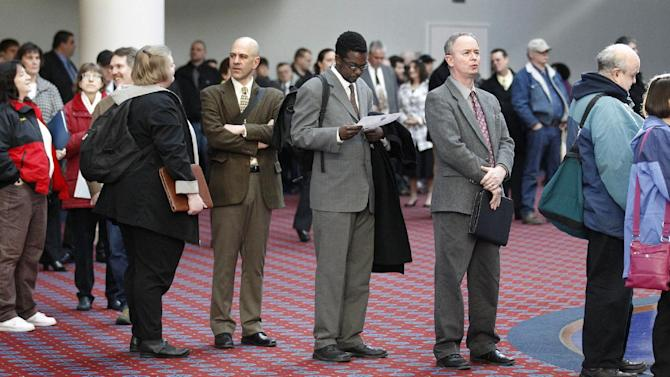 In this March 7, 2012, file photo shows job seekers standing line during the Career Expo job fair, in Portland, Ore.  Employers pulled back sharply on hiring last month, a reminder that the U.S. economy may not be growing fast enough to sustain robust job growth. The unemployment rate dipped, but mostly because more Americans stopped looking for work.  The Labor Department says the economy added 120,000 jobs in March, down from more than 200,000 in each of the previous three months. (AP Photo/Rick Bowmer)