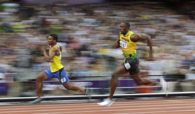 Jamaica's Usain Bolt, right, and Ecuador's Alex Quinonez compete in a men's 200-meter semifinal during the athletics in the Olympic Stadium at the 2012 Summer Olympics, London, Wednesday, Aug. 8, 2012. (AP Photo/David J. Phillip)