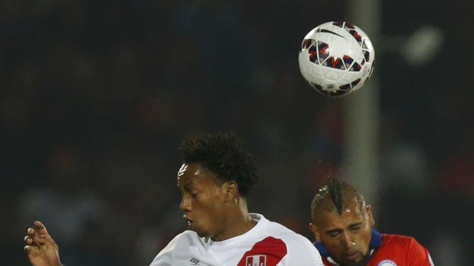 Peru's Carrillo heads the ball with Chile's Vidal during their Copa America 2015 semi-final soccer match at the National Stadium in Santiago