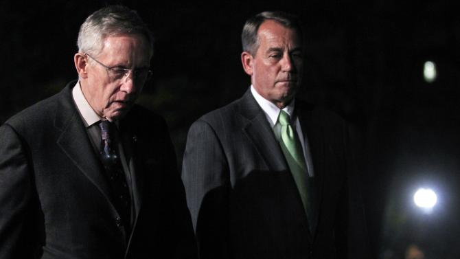 House Speaker John Boehner, R-Ohio, and Senate Majority Leader Harry Reid, D-Nev., walk out to speak to reporters after their meeting at the White House in Washington with President Obama regarding the budget and possible government shutdown, Wednesday, April 6, 2011. (AP Photo/Charles Dharapak)