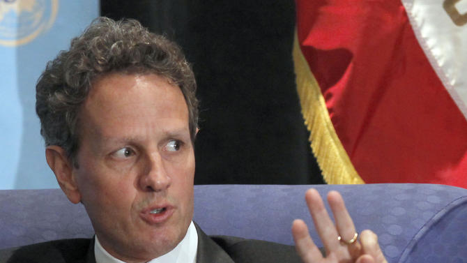 """FILE - In this July 31, 2012 file photo, then U.S. Treasury Secretary Timothy Geithner speaks about the U.S. economy, in Los Angeles. Ben Bernanke, the former chairman of the Federal Reserve; and Geithner's predecessor, Henry Paulson, will be among those appearing with Geithner as he promotes his upcoming book, """"Stress Test,"""" during a two-week tour that will begin in New York on May 14, 2014. (AP Photo/Nick Ut, File)"""