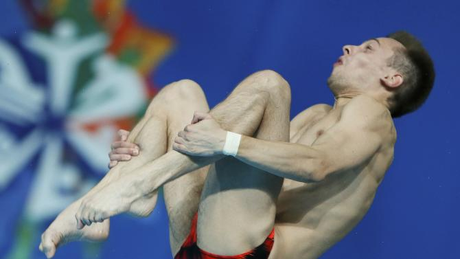 Minibaev of Russia jumps during the men's 10m platform semi-final at the Aquatics World Championships in Kazan