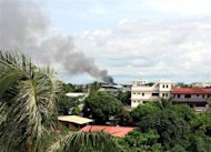 Smoke billows from a residential area in Zamboanga where security forces are battling hundreds of rebels who are holding dozens of civilian hostage September 10, 2013. REUTERS/Stringer