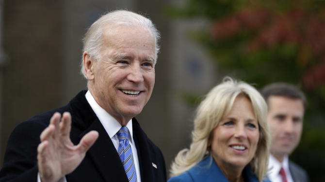 Vice President Joe Biden accompanied by his wife Jill Biden and son Beau Biden waves to members of the media after casting his ballot at Alexis I. duPont High School, Tuesday, Nov. 6, 2012, in Greenville, Del. (AP Photo/Matt Rourke)