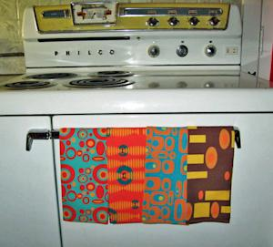 This undated photo courtesy of Renee Pedro/Crash Pad Designs shows the custom tea towels she made for her home in Philadelphia. Pedro has started a business making household goods with fabrics she designs and orders through the Internet. (AP Photo/Courtesy Renee Pedro, Crash Pad Designs)