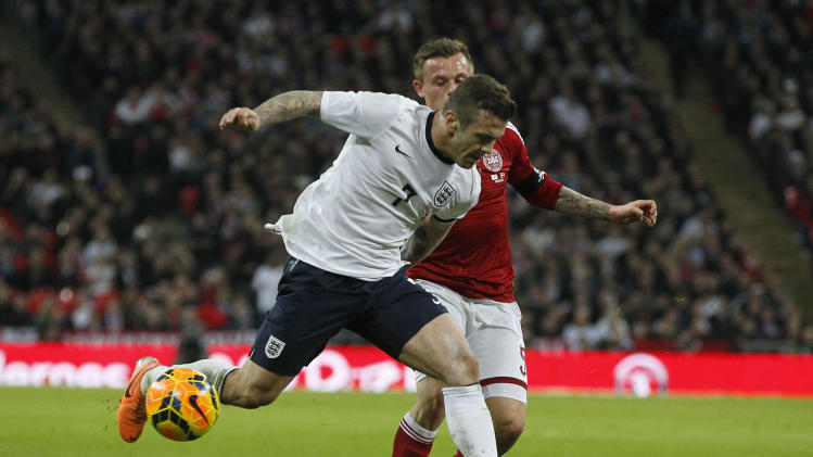 England's Jack Wilshere, front, competes with Denmark's Peter Ankersen during the international friendly soccer match between England and Denmark at Wembley Stadium in London, Wednesday, March 5, 2014. (AP Photo/Sang Tan)