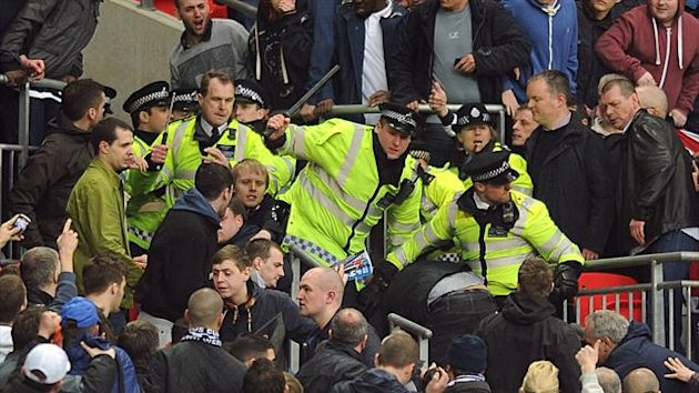 Millwall's FA Cup semi-final against Wigan at Wembley was marred by trouble in the stands