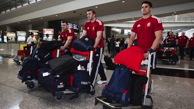 Players of the British and Irish Lions rugby union team arrive at Hong Kong's International Airport (Reuters)