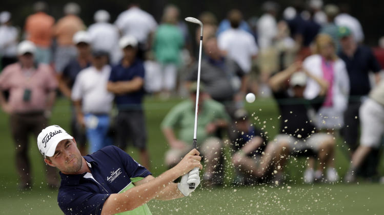 Marc Leishman, of Australia, hits out of a bunker on the 17th fairway during the first round of the Masters golf tournament Thursday, April 11, 2013, in Augusta, Ga. (AP Photo/David J. Phillip)