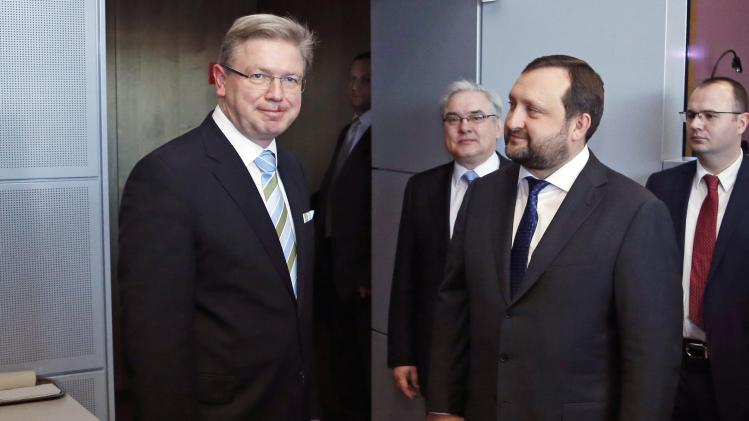European Enlargement Commissioner Fule poses with Ukraine's First Deputy Prime Minister Arbuzov ahead of a meeting in Brussels